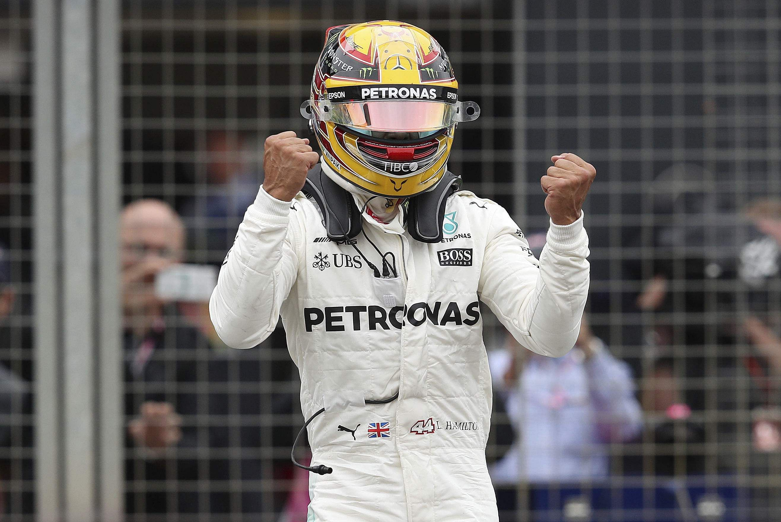 Mercedes driver Lewis Hamilton of Britain celebrates after he clocked the fastest time during the qualifying session for the British Formula One Grand Prix. | AP