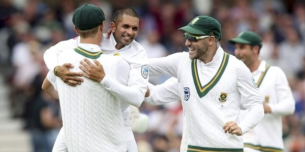 South Africa's Keshav Maharaj, second left, celebrates taking the wicket of England's Ben Stokes during day two of the Second Test match. | AP
