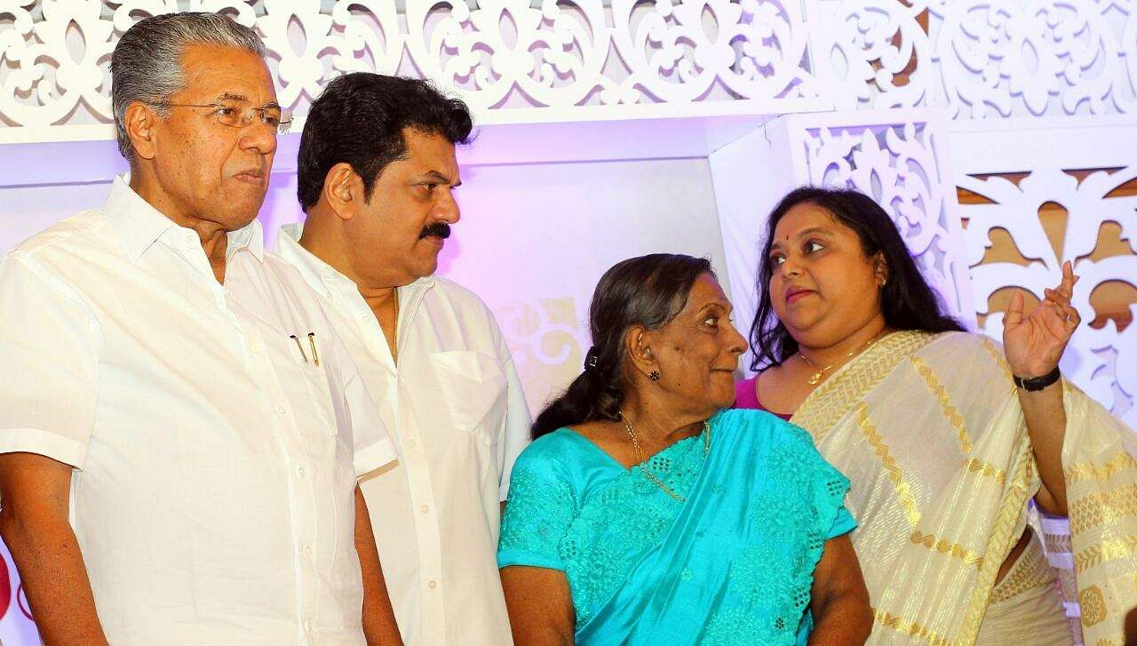 Kerala Chief Minister Pinarayi Vijayan graced the pooja ceremony of debutante Shravan Mukesh's film 'Kalyanam'. The budding actor is the son of estranged actors Mukesh and Saritha. Also seen in the picture is Mukesh's mother, Vijayakumari.  (Photo: Kaviyoor Santhosh | Express Photo Service)