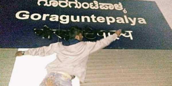 File photo of a Kannada activist defacing the Hindi sign at the Goraguntepalya Metro Station   Express