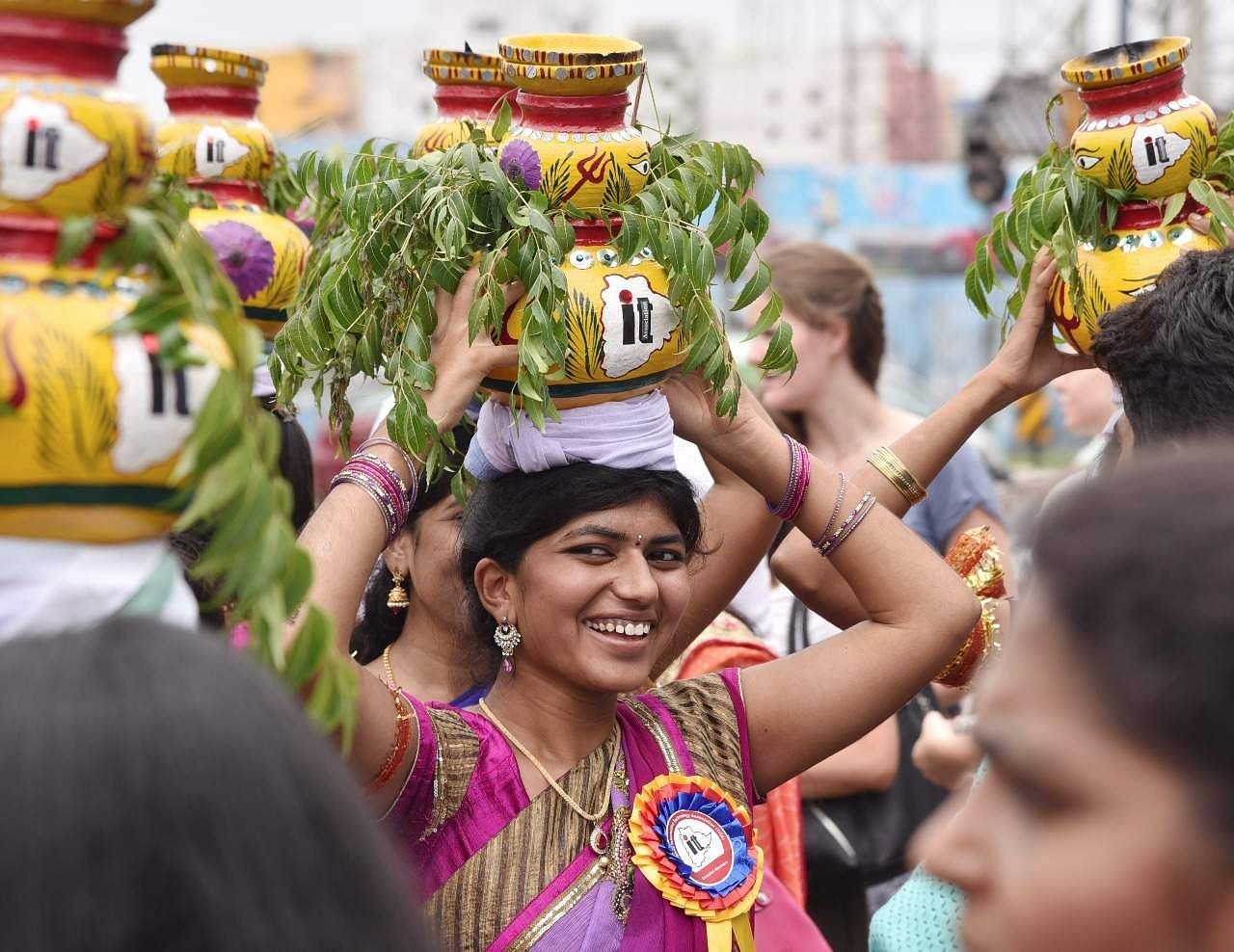 Women turn out in traditional sarees and jewellery, while young girls wear a half sari or lehenga on the day of the festival. They gather together and go in procession to the temple, carrying on their heads pots filled with the special dishes they cooked at home to offer to the Goddess. (R Satish Babu | Express Photo Service)
