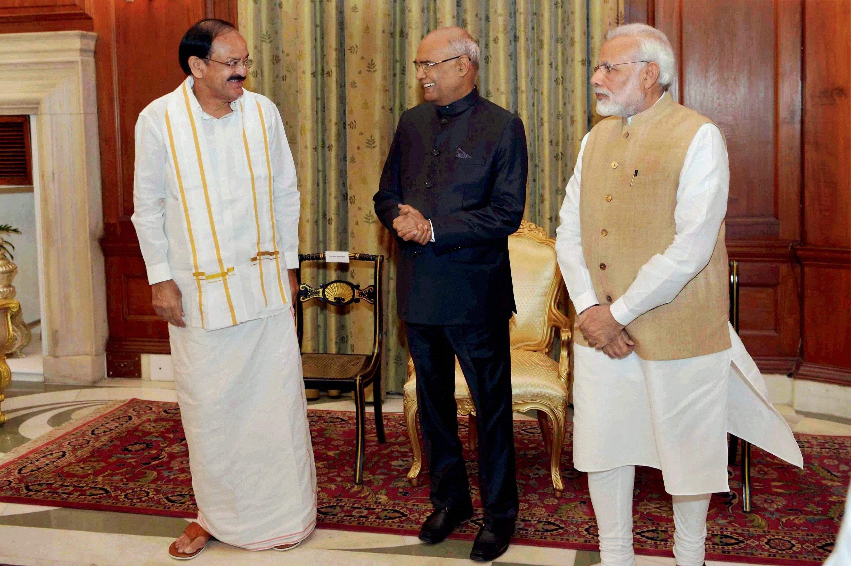 Vice President Venkaiah Naidu, President Ram Nath Kovind and Prime Minister Narendra Modi. Image: PTI