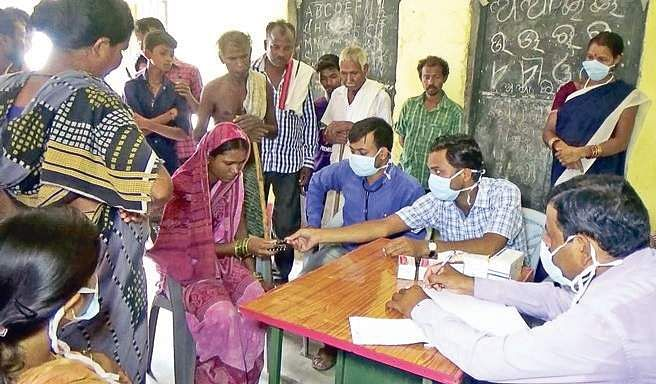Patients suffering from cold attending a medical camp for a check-up at Bardol in Bargarh on Friday | Express