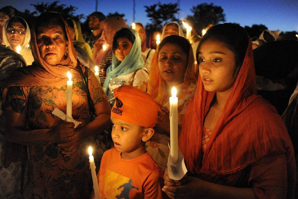 Sikh Americans across the country marked the tragic anniversary of Oak Creek massacre by conducting seva, a central tenet of Sikhism requiring selfless service to those in need, visible through the hashtag #RememberOakCreek. ( Photo | AP )