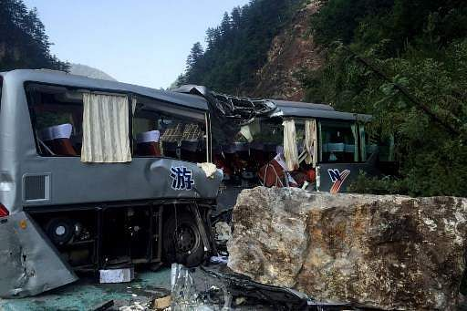 At least 12 people were killed when a 6.5-magnitude earthquake struck southwestern China on Tuesday. A tour bus damaged during an earthquake is seen in Jiuzhaigou. ( Photo | AFP )