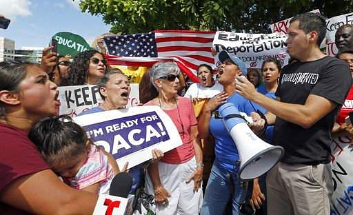 Immigration rights activists chant anti-Trump slogans as they urge Republican lawmakers in Florida to firmly oppose President Donald Trump's proposals to increase funding for immigration enforcement as deadlines for budget decisions near in Congress, Tuesday, Aug. 8, 2017, in Doral, Fla.|PTI