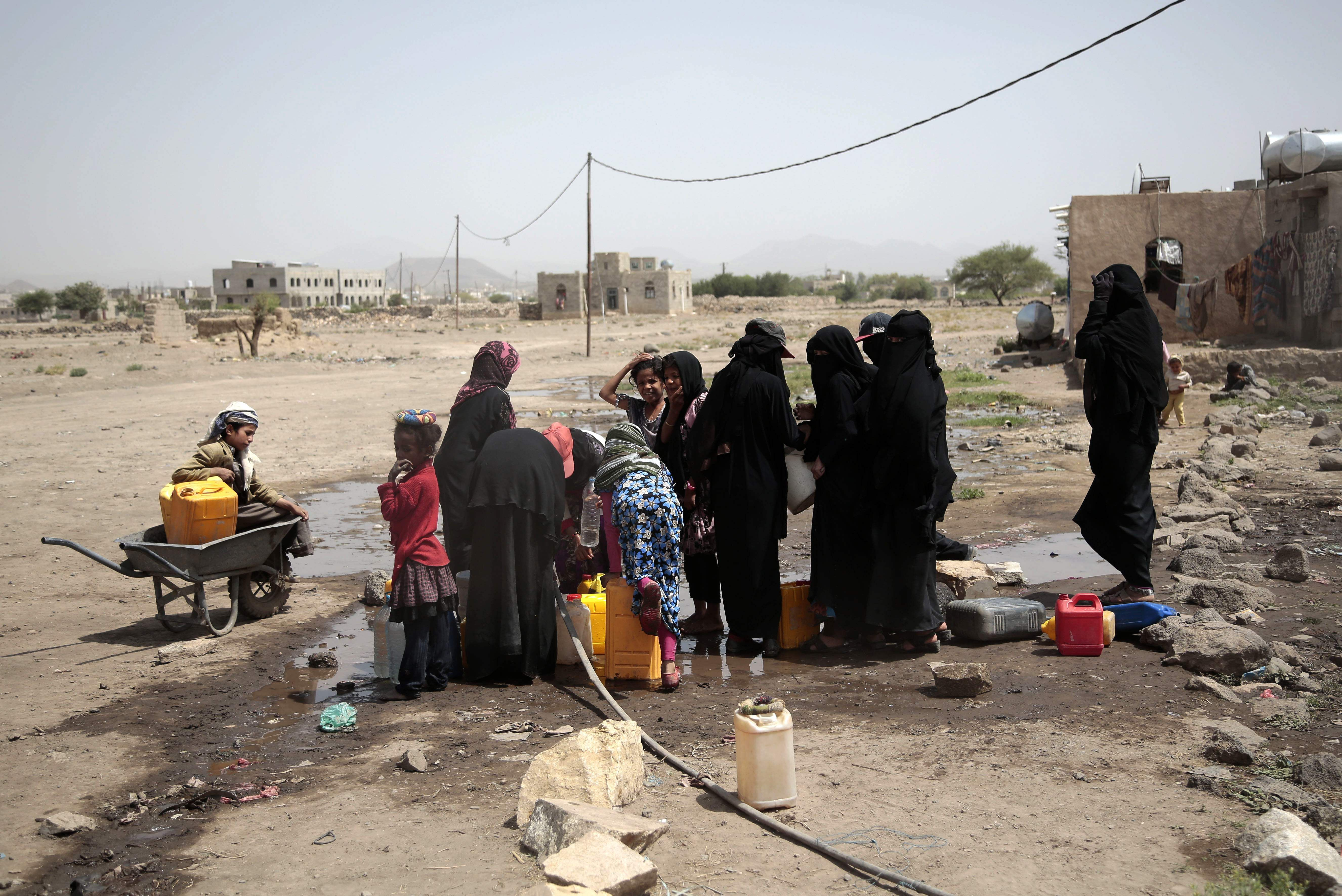 People filling buckets with water from a well that is suspected to be contaminated water with the bacterium Vibrio cholera, on the outskirts of Yemen. (Photo | AP )