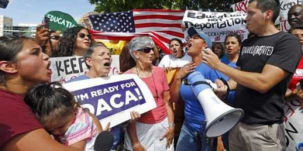 Immigration rights activists chant anti-Trump slogans as they urge Republican lawmakers in Florida to firmly oppose President Donald Trump's proposals to increase funding for immigration enforcement as deadlines for budget decisions near in Congress, Tues