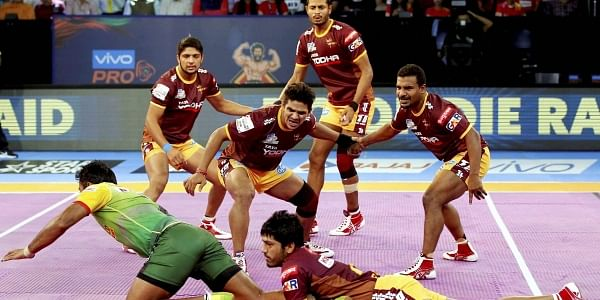UP Yoddha and Patna Pirates players in action during the Pro Kabaddi League match in Ahmedabad on Sunday. | PTI