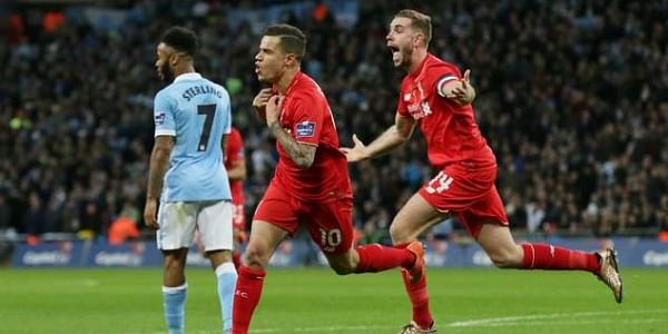 Liverpool's Philippe Coutinho, center, with Jordan Henderson. | File | AP