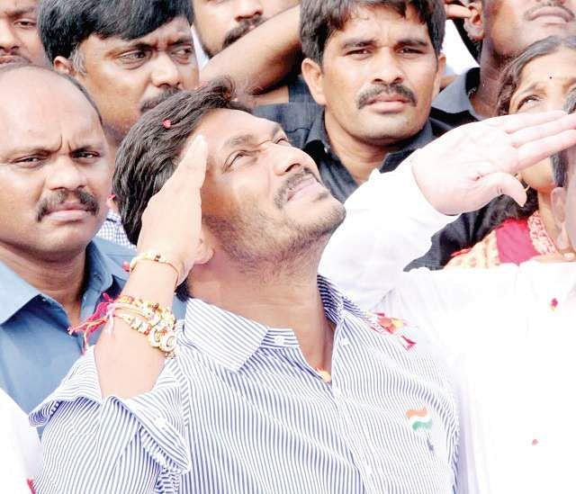 YSRC chief Y S Jagan Mohan Reddy salutes the tricolour after hoisting it during a party programme in Nandyal on Tuesday