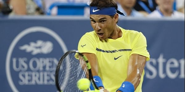 Rafael Nadal, of Spain, returns to Richard Gasquet, of France, during the middle rounds at the Western and Southern Open tennis tournament. | AP