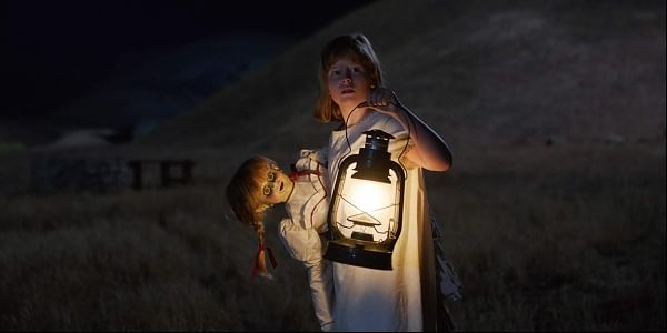 This image released by Warner Bros Pictures shows Lulu Wilson in 'Annabelle: Creation.' (Warner Brothers Pictures via AP)