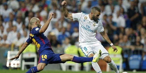 Real Madrid's Karim Benzema, right, vies for the ball with Barcelona's Javier Mascherano during the Spanish Super Cup second leg soccer match between Real Madrid and Barcelona at the Santiago Bernabeu Stadium. | AP