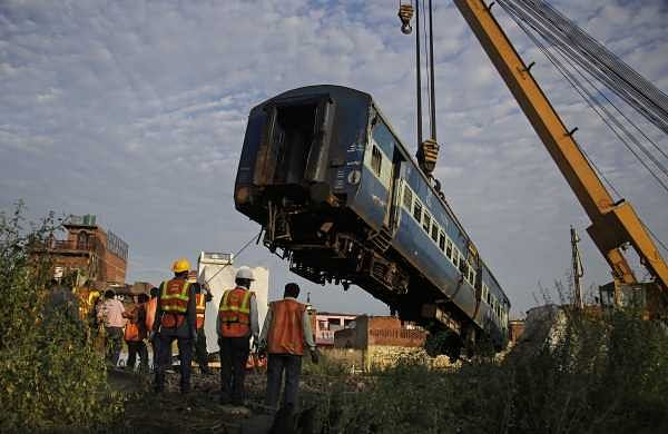 Workers remove an upturned coach of the Kalinga-Utkal Express from the track after an accident near Khatauli, in Uttar Pradesh. (Photo   AP)