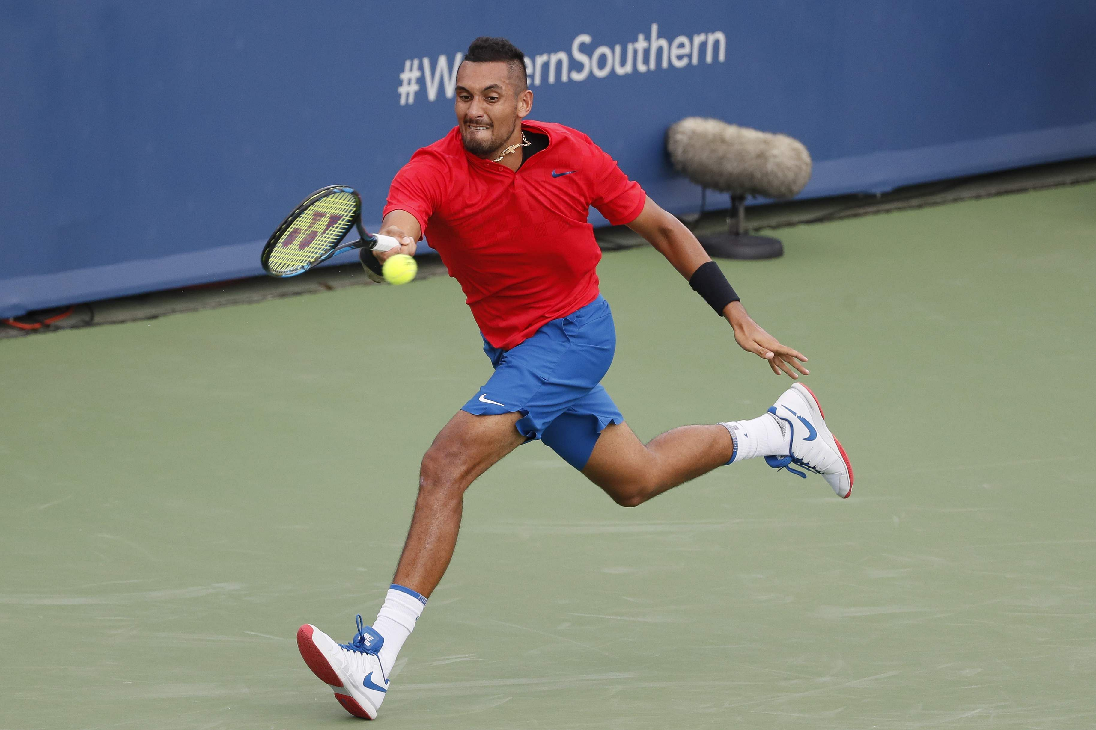 Nick Kyrgios, of Australia, returns to Grigor Dimitrov, of Bulgaria, during the men's singles final at the Western and Southern Open in Ohio. | AP