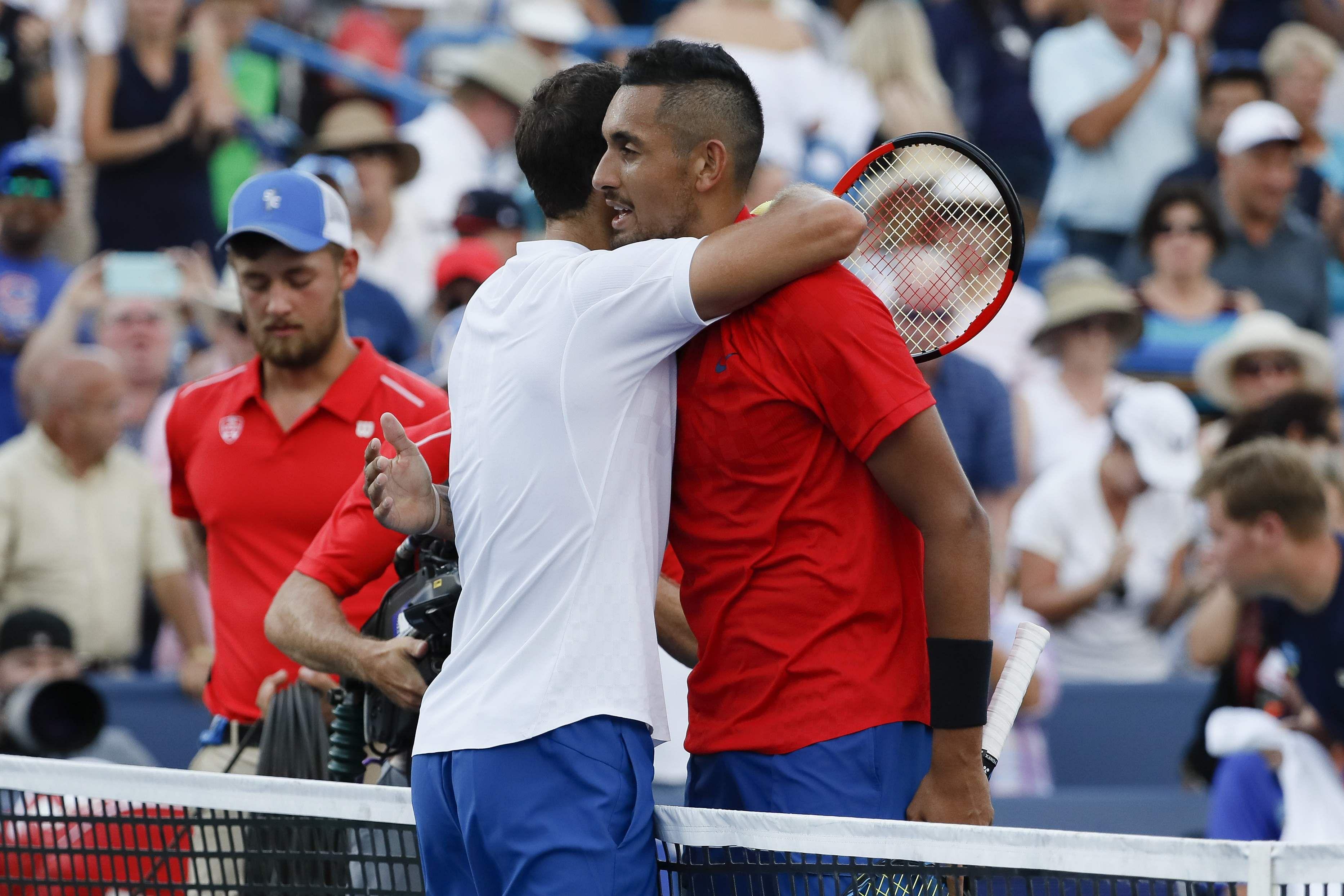 Grigor Dimitrov, of Bulgaria, left, hugs Nick Kyrgios, of Australia, after winning the men's singles final at the Cincinnati Masters. | AP
