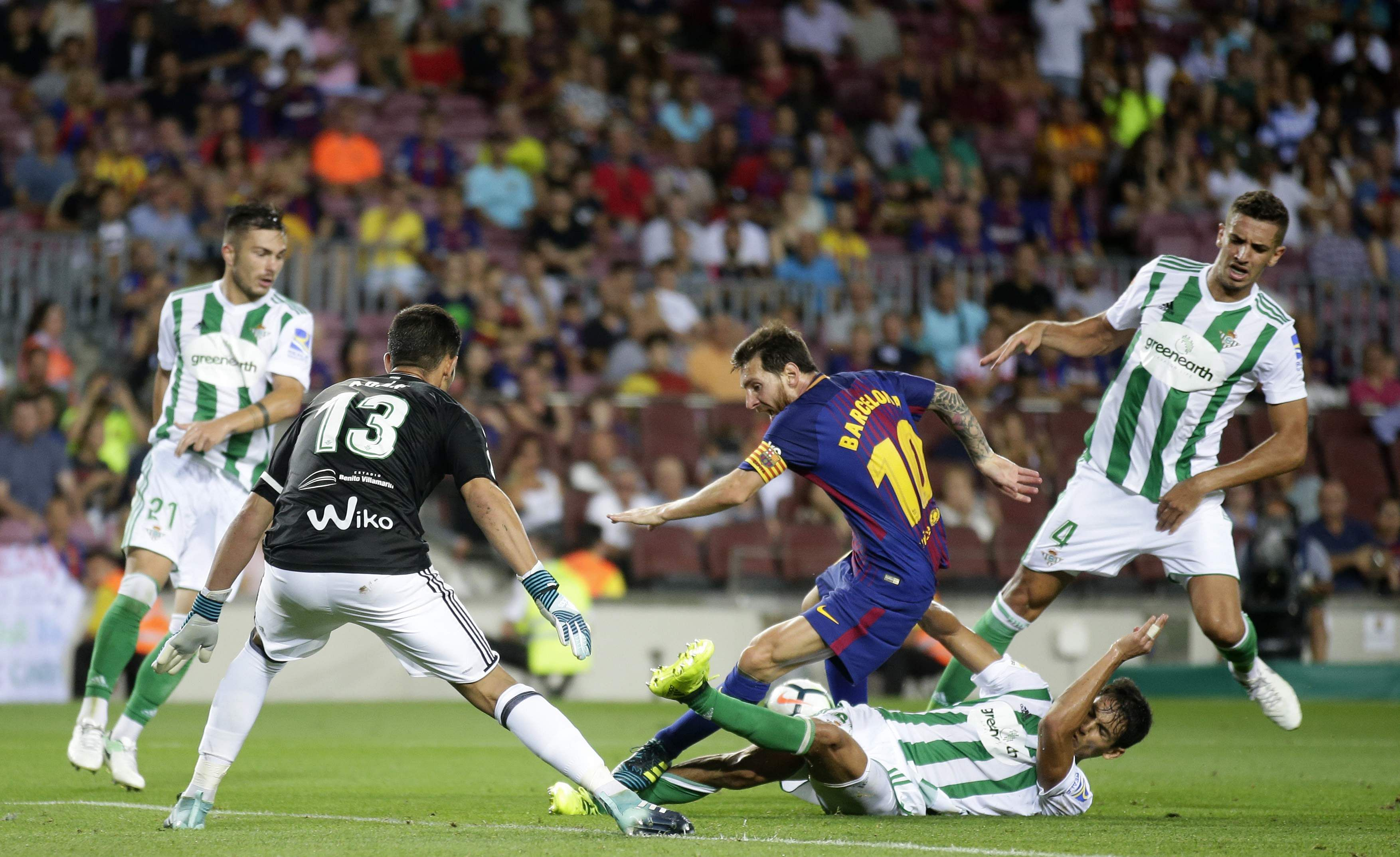 FC Barcelona's Lionel Messi, center, in action during the Spanish La Liga soccer match between FC Barcelona and Betis at the Camp Nou stadium in Barcelona, Spain. | AP