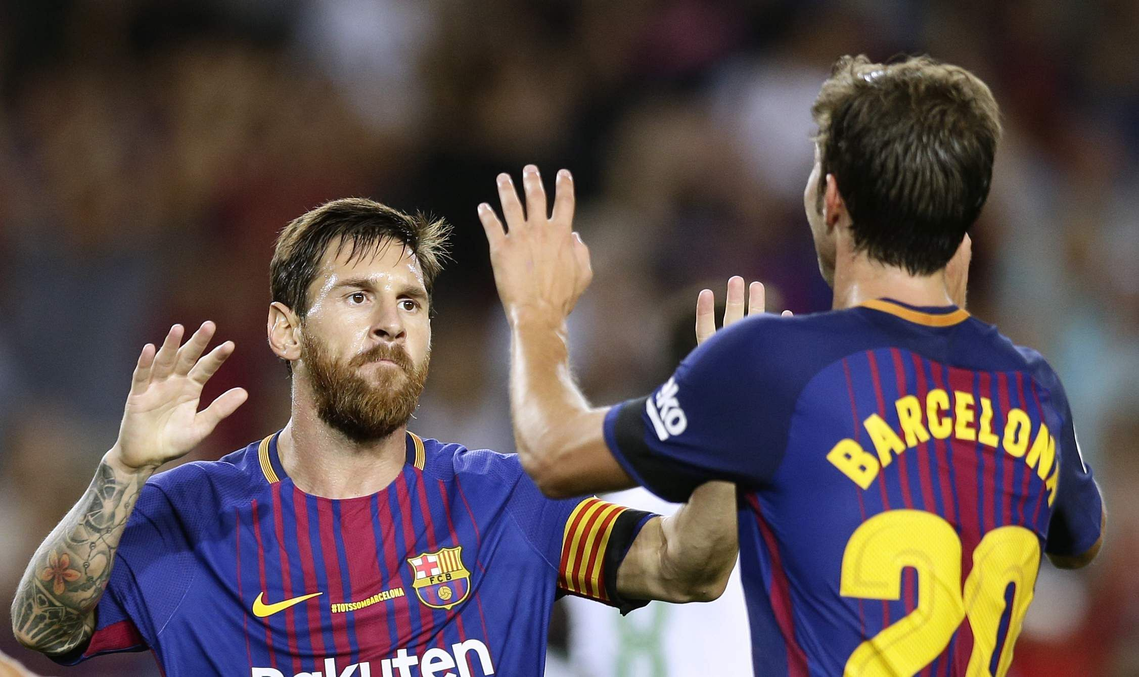 FC Barcelona's Sergi Roberto, right, celebrates after scoring with his teammate Lionel Messi during the Spanish La Liga soccer match between FC Barcelona and Betis at the Camp Nou stadium in Barcelona. | AP