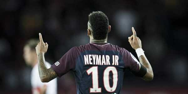 PSG's Neymar celebrates after scoring against Toulouse during the French League One soccer match between PSG and Toulouse at the Parc des Princes stadium in Paris.   AP