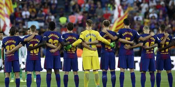 Barcelona players stand for a minute of silence for the victims of the van attacks before a La Liga soccer match between Barcelona and Betis. Barcelona players are all wearing shirts with 'Barcelona' on their backs tonight, rather than their names to pay