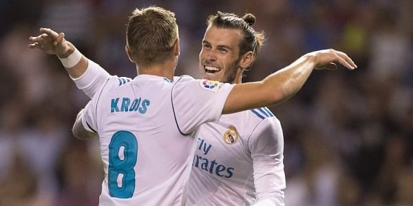 Real Madrid's Toni Kroos, left, is congratulated by Real Madrid's Gareth Bale after scoring a goal during the Spanish La Liga match between Deportivo and Real Madrid. | AP