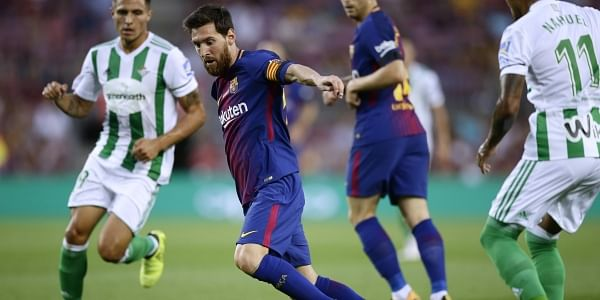 FC Barcelona's Lionel Messi, second left, in action during the Spanish La Liga soccer match between FC Barcelona and Betis at the Camp Nou stadium in Barcelona. | AP