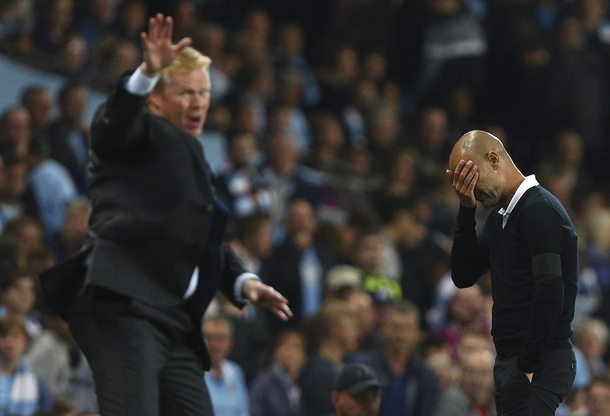 Everton manager Ronald Koeman, left, and Manchester City manager Pep Guardiola react during the English Premier League soccer match between Manchester City and Everton. | AP