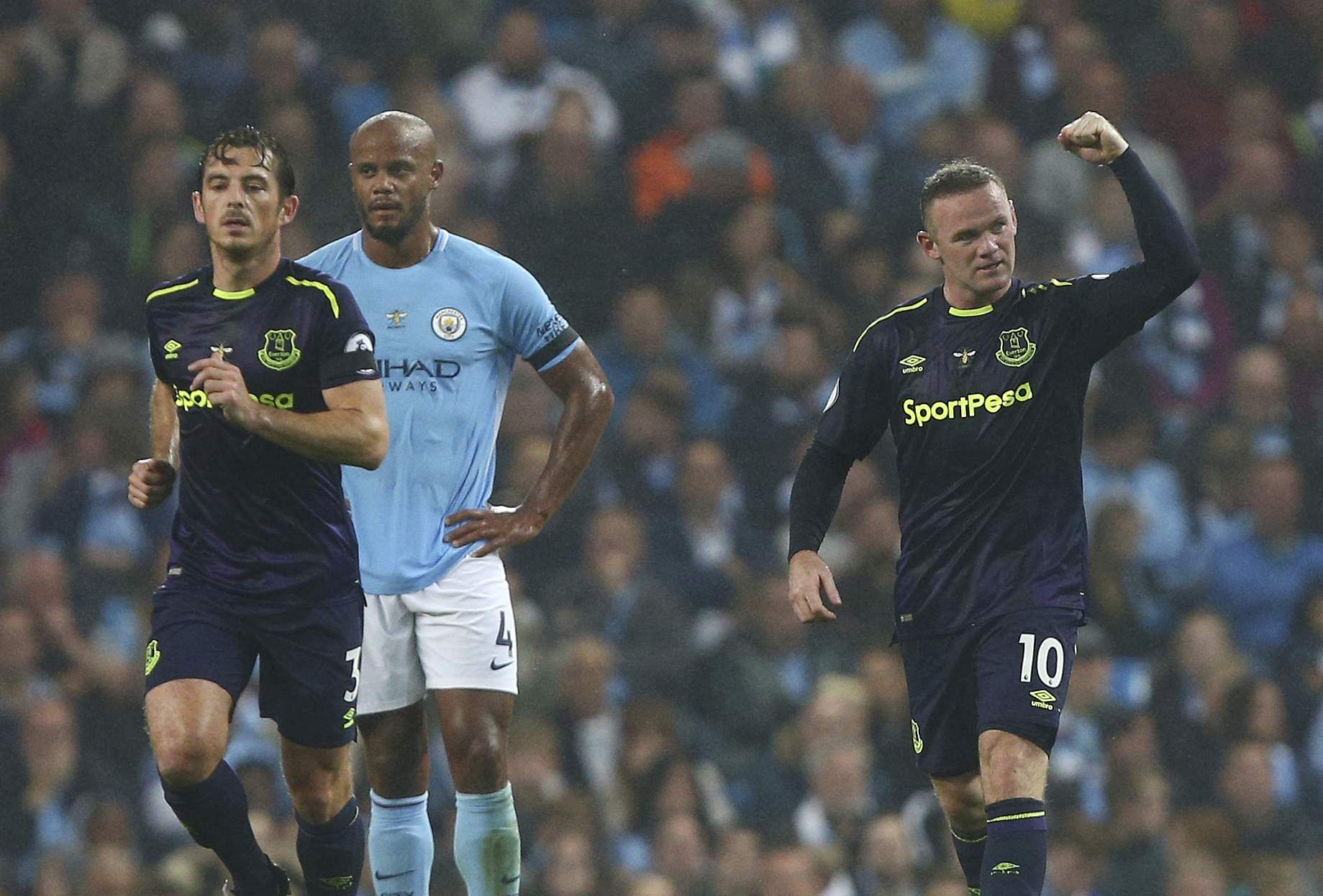 Everton's Wayne Rooney, right, celebrates scoring his side's first goal of the game during the English Premier League soccer match between Manchester City and Everton at the Etihad Stadium. | AP
