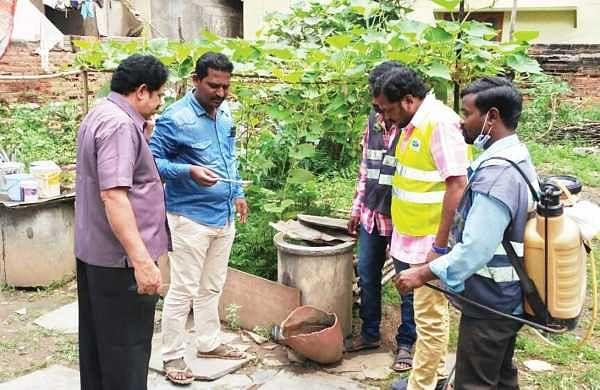 Entomology team of Moosapet circle inpecting stagnant water at Avanti Nagar on Monday   Express photo