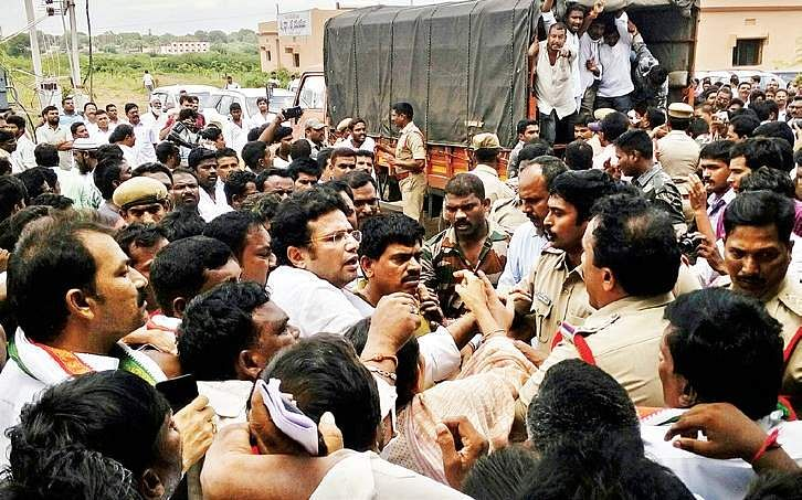 Police arresting former minister D Sridhar Babu and Congress activists at a public hearing on Kaleshwaram project at Raghavapur on Wednesday   Express PHoto