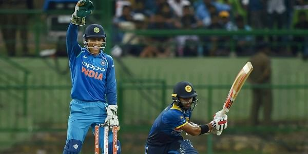 Indian wicket-keeper Mahendra Singh Dhoni successfully appeals for the dismissal of Sri Lanka's Kusal Mendis during the second ODI match at Pallekele International Cricket Stadium in Kandy on Thursday. (Photo   PTI)