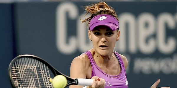 Poland's Agnieszka Radwanska returns a volley to Peng Shuai, of China, in the quarterfinals of the Connecticut Tennis Open in New Haven. | AP