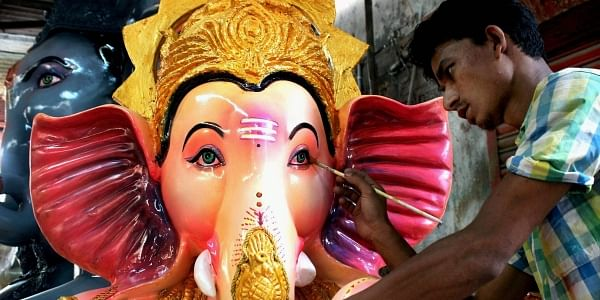 An artist gives final touches to an idol of Lord Ganesha ahead of Ganesh festival in Nagpur, Maharashtra. (PTI)