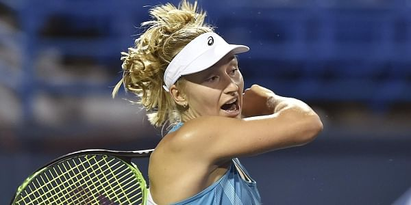 Daria Gavrilova, of Australia, follows through on a return to Poland's Agnieszka Radwanska in the semifinals of the Connecticut Open tennis tournament.   AP