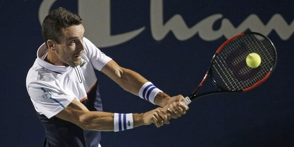 Roberto Bautista Agut, of Spain, returns a shot against Jan-Lennard Struff, of Germany, during a semifinal of the Winston-Salem Open tennis tournament. | AP