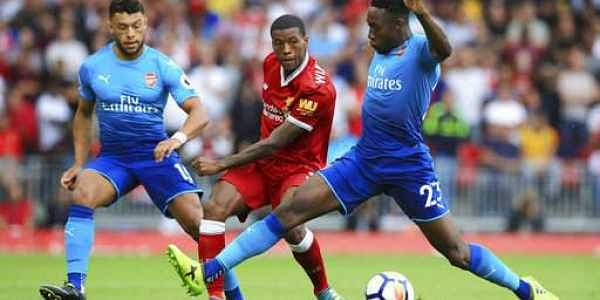 Arsenal's Alex Oxlade-Chamberlain, left, and Arsenal's Danny Welbeck, right, battle for the ball with Liverpool's Georginio Wijnaldum during the English Premier League soccer match at Anfield, Liverpool, England, Sunday, Aug. 27, 2017.|AP