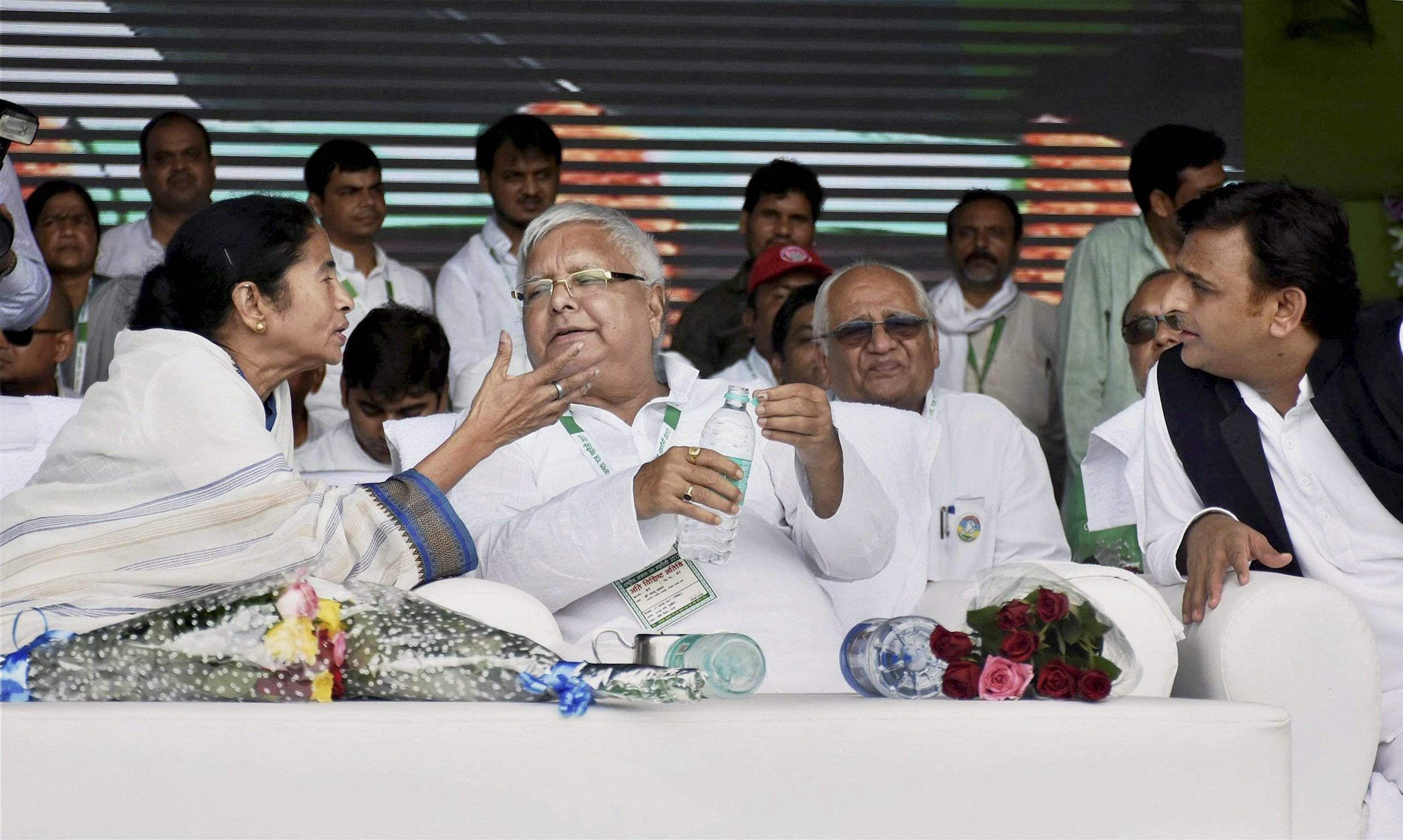 Mamata Banerjee (left) with Lalu Prasad Yadav (centrer) and Akhilesh Yadav (right). (Photo | PTI)