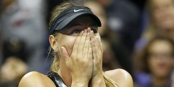 Maria Sharapova reacts after defeating Simona Halep 6-4, 4-6, 6-3 in their opening round match in the U.S. Open tennis tournament in New York. | AP