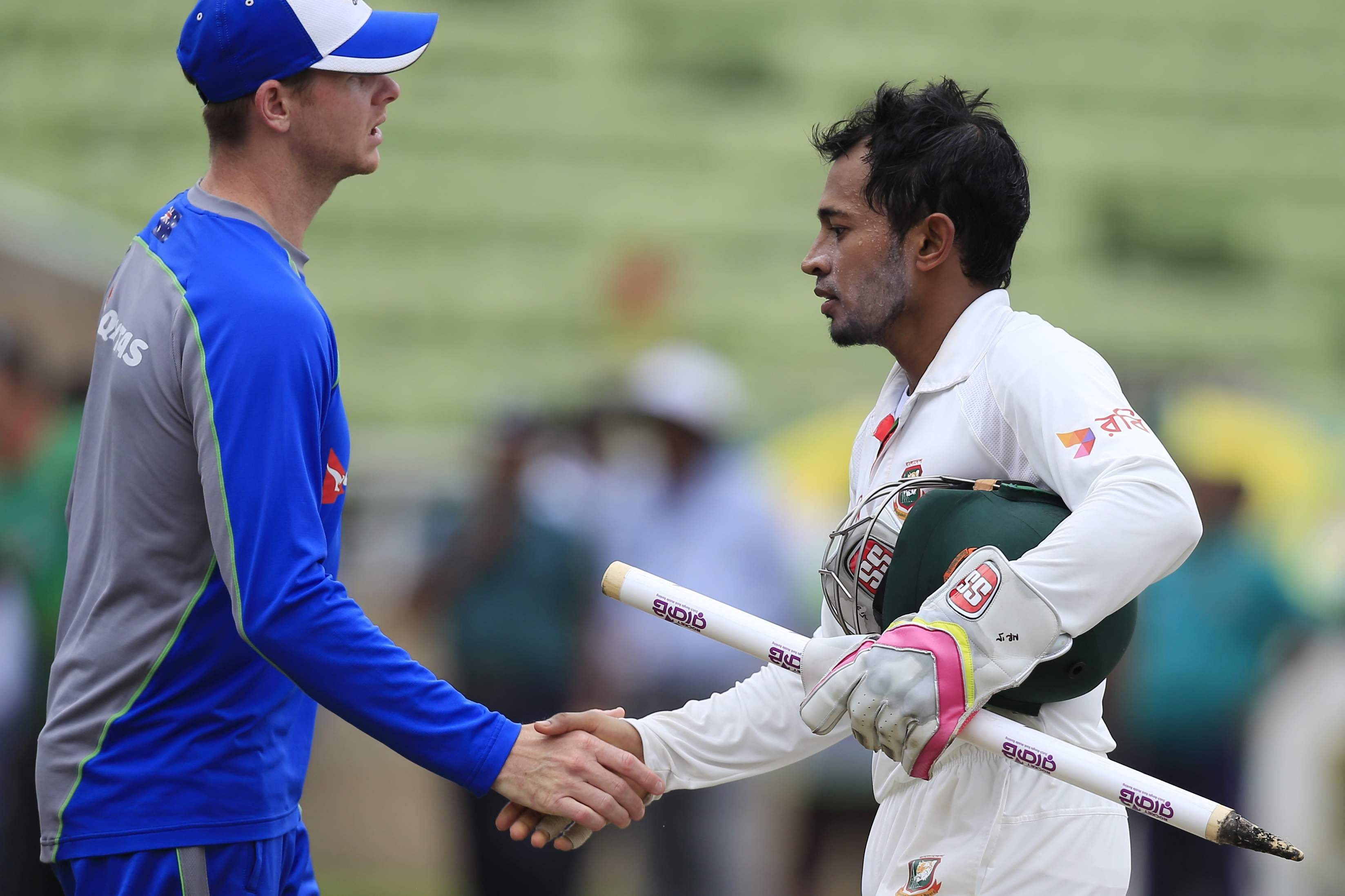 Bangladesh cricket team captain Mushfiqur Rahim, (R), shakes hand with his Australian counter-part Steve Smith at the end of the match. (Photo | AFP)