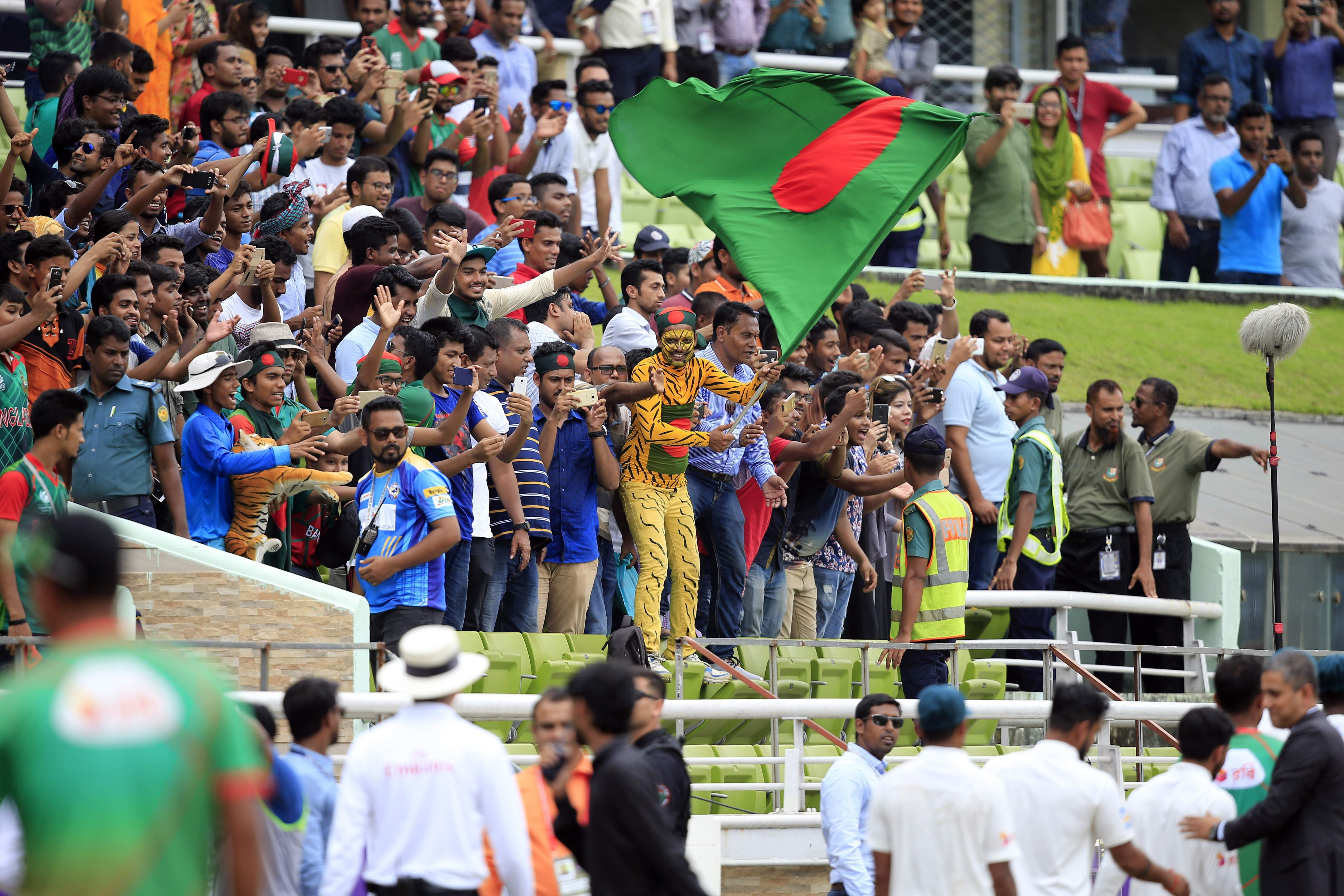 Bangladesh fans celebrate their team's victory over Australian at the Shere Bangla National Stadium, Dhaka. (Photo | AP)