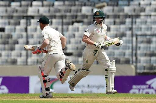 Australian cricket captain Steven Smith (right) and David Warner run between the wickets during the fourth day of the match. (Photo | AFP)