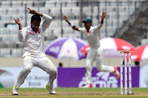 Bangladesh cricketer Shakib Al Hasan (L) reacts after the dismissal of the Australia's Matthew Wade. (Photo | AFP)