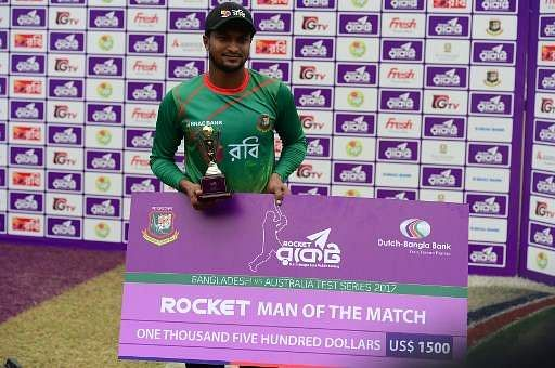 Bangladesh all-rounder Shakib Al Hasan poses for a photo with the Man of the Match prize following the post-match ceremony. (Photo | AFP)
