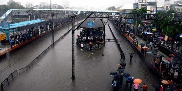 Thane railway station is completely flooded bringing central Railway trains to a halt after heavy rains lashed Thane in Mumbai on Tuesday. (Photo | PTI)