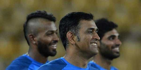 Indian cricketer Mahendra Singh Dhoni (C), Bhuvneshwar Kumar (R) and Hardik Pandya (L) look on during a practice session at The R.Peremadasa Stadium in Colombo on August 30, 2017.|AFP