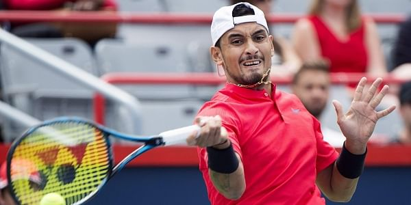 Nick Kyrgios, of Australia, returns to Viktor Troicki, of Serbia, during a first round match at the Rogers Cup tennis tournament in Montreal. | AP