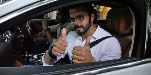 Former Indian cricketer S Sreesanth gives a thumbs-up to his supporters as he leaves the Kerala High Court after the court lifted the life ban on him for spot-fixing.   Express Photo Service   K Shijith