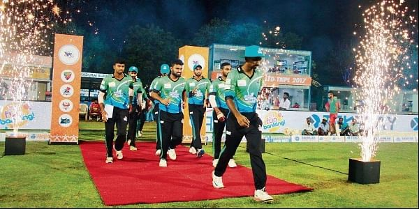 VB Thiruvallur Veerans enter the field of play ahead of their match against Madurai Super Giant in Tirunelveli on Tuesday. | Express Photo Service
