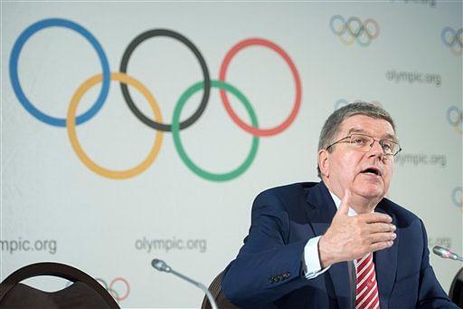 Putin won't block athletes from Olympics amid anger at ban